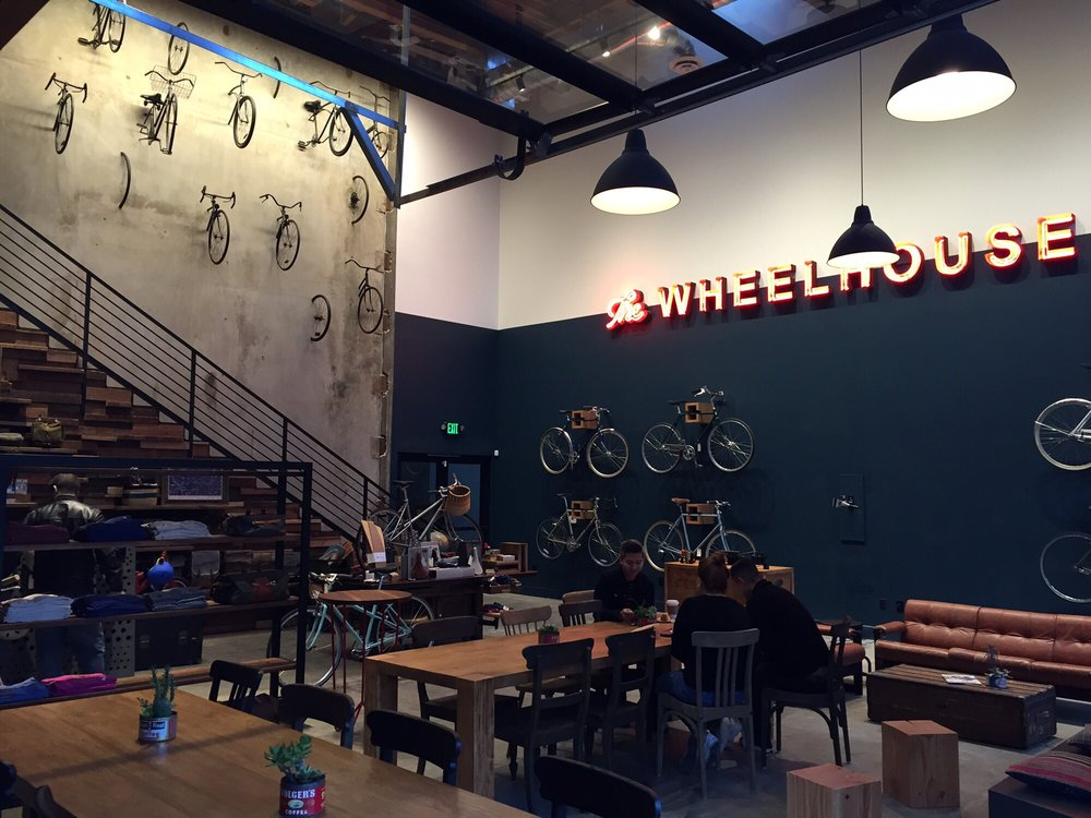 People sit side-by-side with bikes at The Wheelhouse