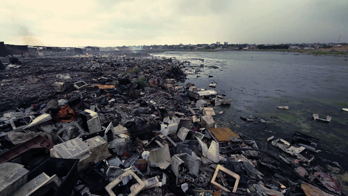 An e-waste dump polluting a lake in Agbogbloshie, Ghana