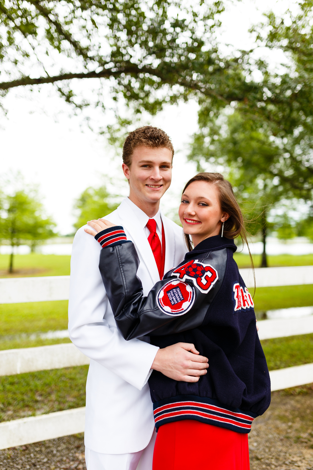 Comeaux High Letter Jacket Prom Portrait on bridge at Cypress Bend Farm in Youngsville