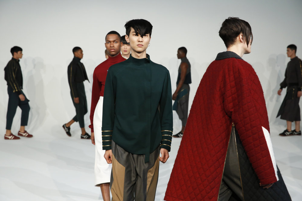 FALL-WINTER 2016 RUNWAY AT PIER 59 IN NEW YORK CITY, NEW YORK     tHIS COLLECTION SERVED AS THE FIRST WOOD HOUSE SHOW IN THE UNITED STATES. FROM THE BEGINNING DESIGNER, JULIAN WOODHOUSE SPOKE OF THREE ELEMENTS HE WANTED TO INCORPORATE INTO THE SHOW: ETHNIC AND RACIAL DIVERSITY, MINIMALISM, AND DYNAMIC MOVEMENT.