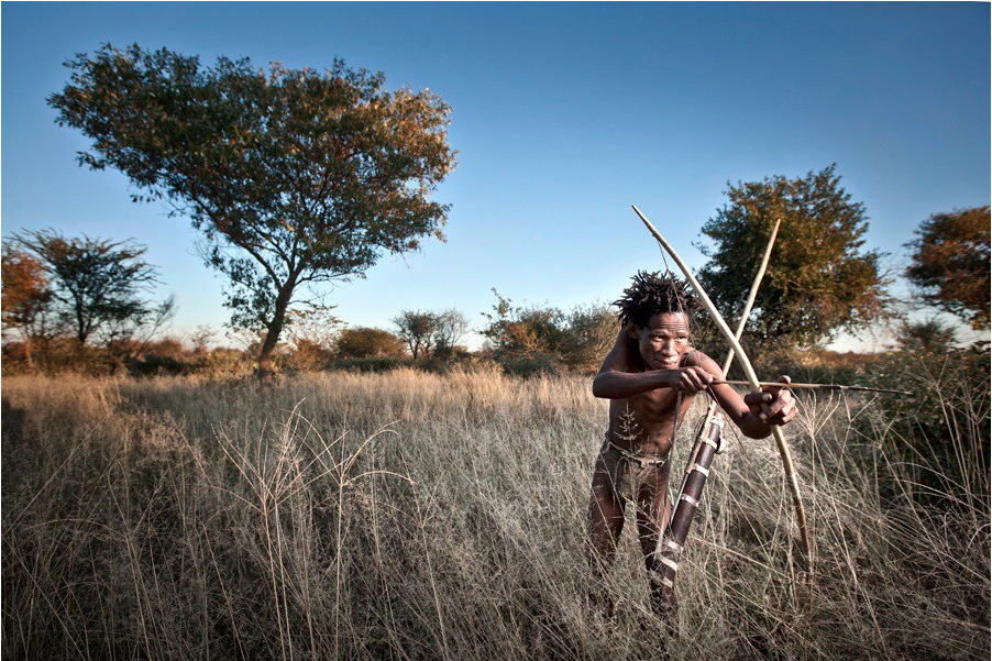 Xaoxam poses for the camera with the bow and arrow he has made; the arrow tipped with lethal neuro-toxic beetle larvae.