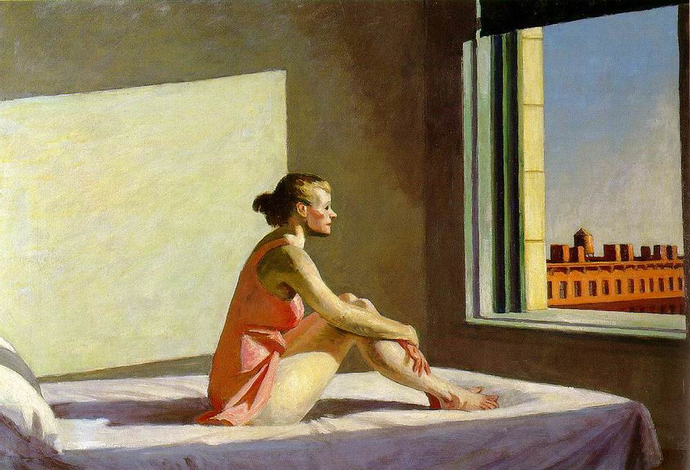 "Edward Hopper's ""Morning Sun"" (1952) depicts the solitude of urban life. The window casts a stark light on the figure. We wonder what she is thinking as she gazes out over the rooftops. Image courtesy of Columbus Museum of Art.inw"
