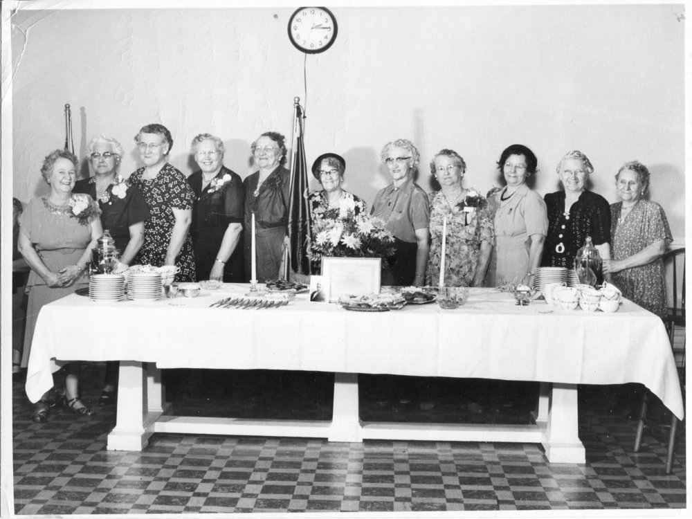 April 25, 1953 Tea   Mae Rees Grandmother's Club 1951-1953 Toledo, Ohio left to right: Lillian Woods, Jean Christie, Edith Provonsha, Norma Wade, Ida Schultz, Millie Rausch, Nora Hall, Clara MacDonald, Mrs. Braunschwiger, Mabel Fox and Elsie Albright. The photo wad donated from Clara MacDonald's Granddaughter.  Clara was born 1981 and passed away 1977.