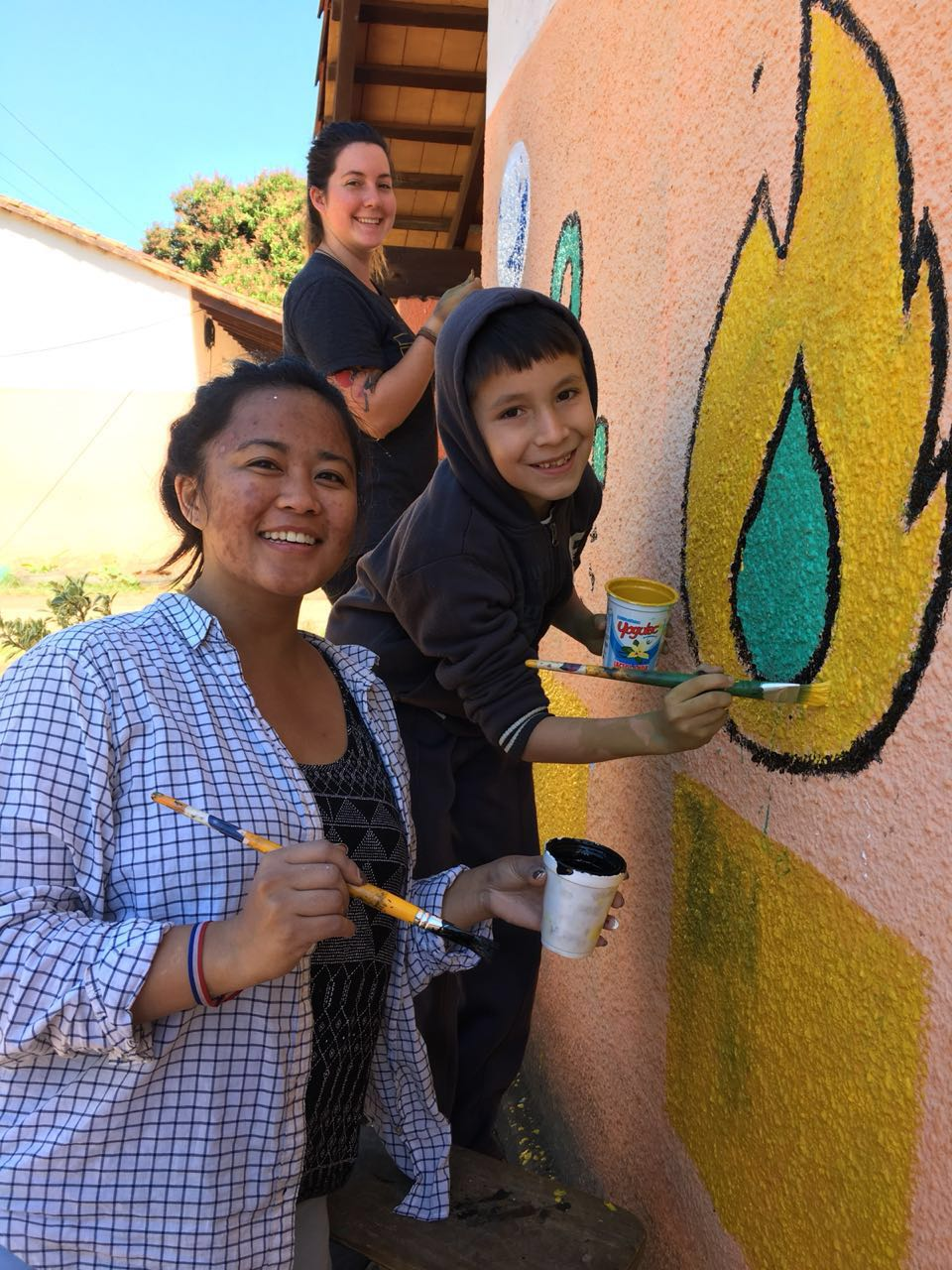 PCVs Whit and Simone work with 4th grade Niño Profe Axel to give his school a makeover