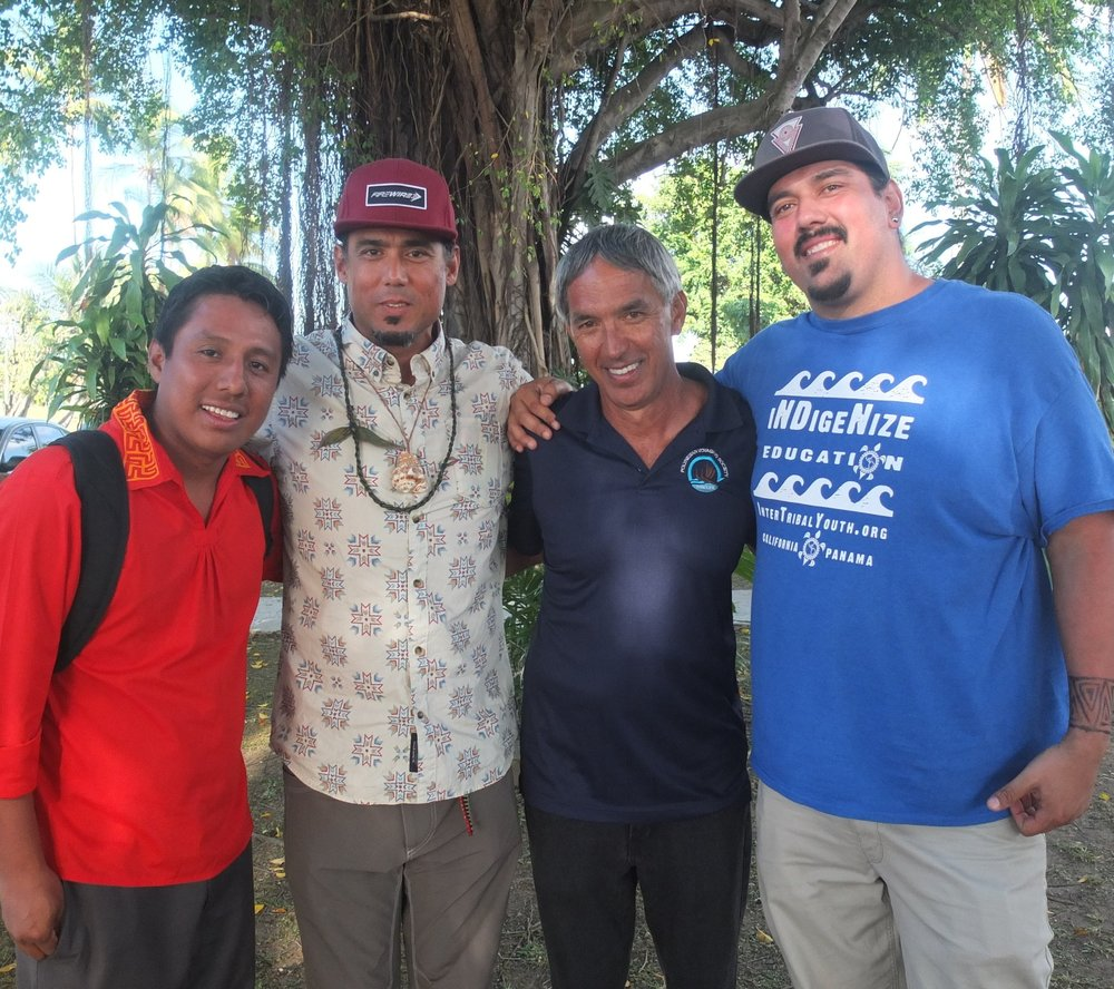 Marc, second from Left, during Hokulea's historical Crossing of the Panama Canal. Pictured aside Hokulea's Captain and living legend Nainoa Thompson and flanked by Olo Villalaz (4 Worlds) and ITY Assist. director Manny Lieras