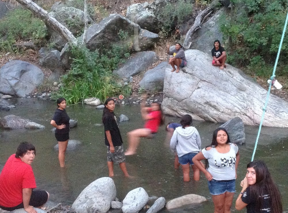 La Jolla Reservation Campground with Environmental Protection Agency. Youth measure the flow of the river that feeds San Diego County.