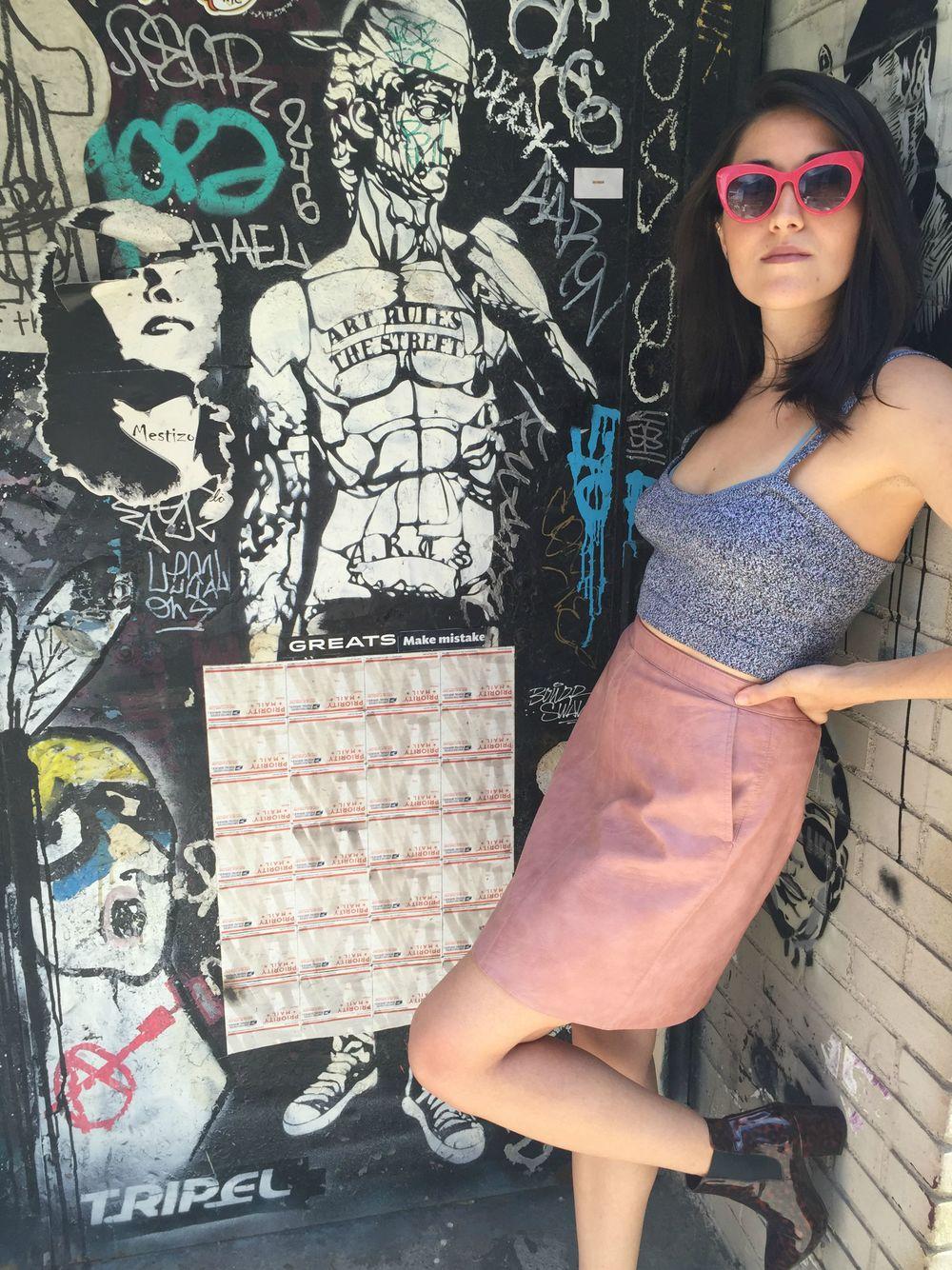 PInk Leather Skirt Leaning Dark.jpg