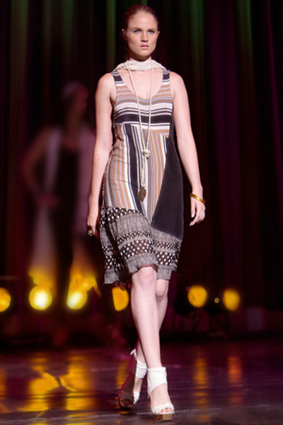 Breanna Baker walking in Reno Fashion Show by Janice Dickinson.png