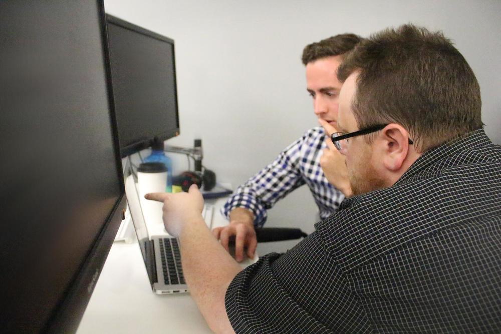Kyle Simpson   working with student   Ryan Jones