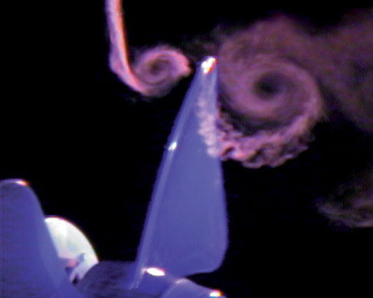 Spiraling smoke vortices produced by rapidly rotating fan blades.