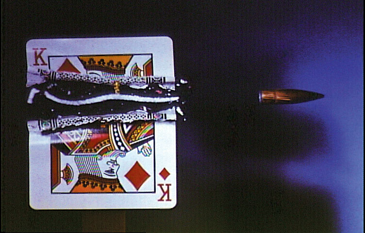 As it rips the card in half, the rotating bullet carves out a spiral shaped slice of card.