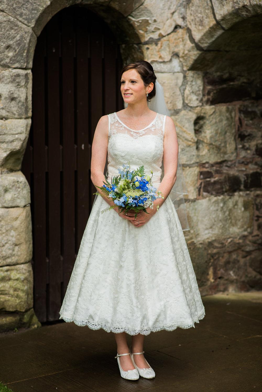 Bride wearing Dragonfly Dress Design Wedding Dress