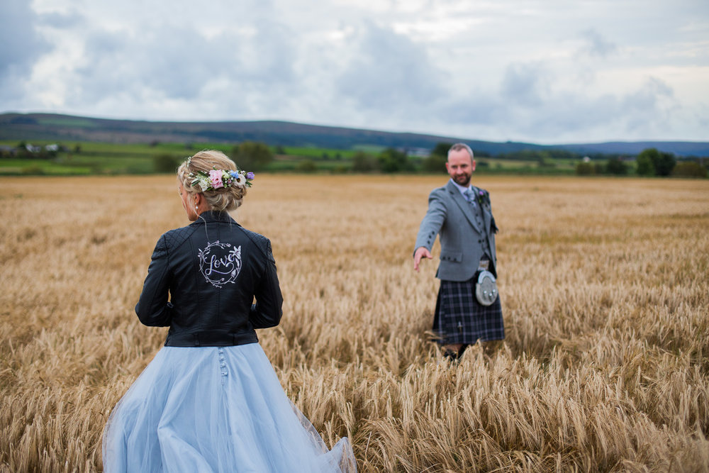 Couple in barley field at Dalduff Farm Wedding