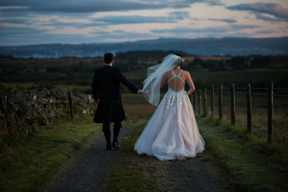 Bride and Groom walking for Loch Lomond Wedding