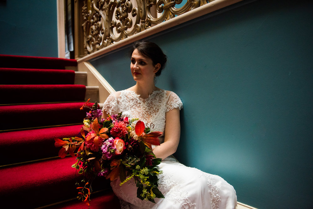 The stairs - Most photographers have done the big wide shot of the main staircase and why not, it's spectacular. I wanted to focus on the colours - the stairs, the walls, the bannisters and the light bouncing off the dress, flowers and brides face.