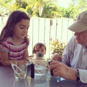 Lili and Tata (my dad) conduct an experiment (with little brother Lucas)