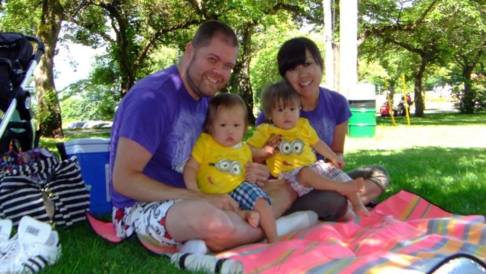 Michae today with his wife and twin boys.