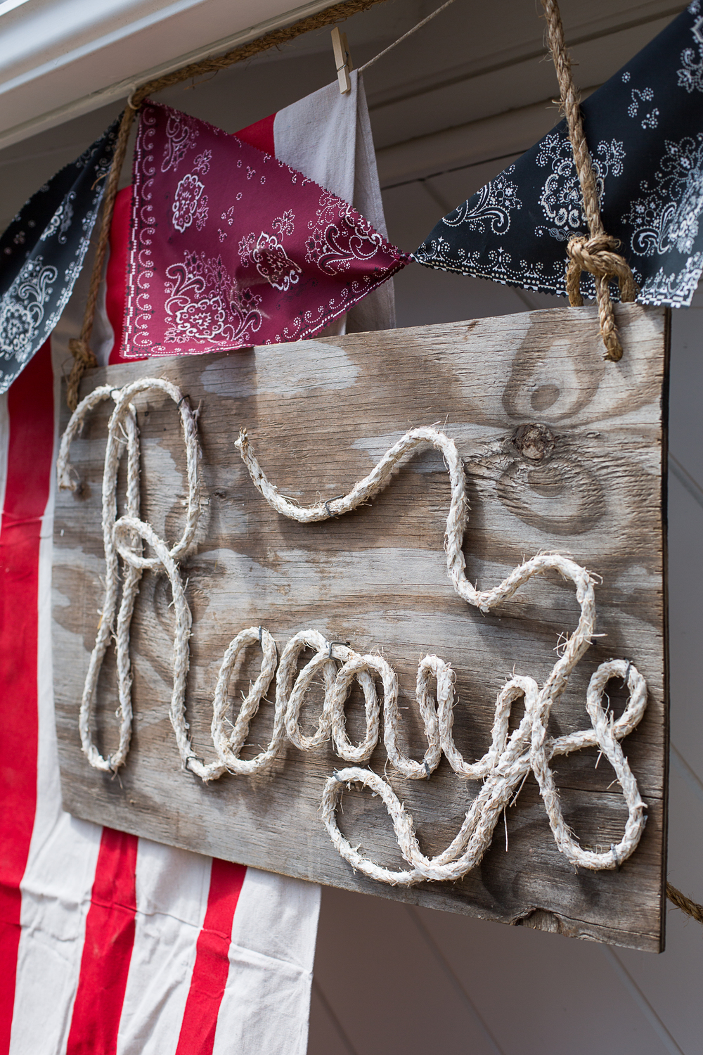 A DIY rope sign (so simple!).  Follow the instructions available at Love Grows Wild (http://lovegrowswild.com/2013/08/how-to-make-rope-letters/).  I used hemp rope because that is what I had laying around.