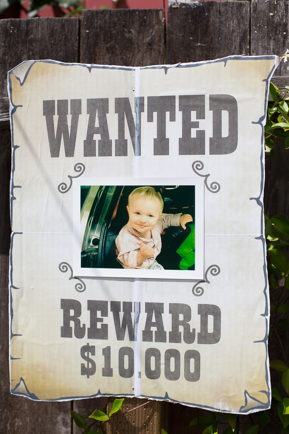 DIY Wanted Signs featuring the birthday boy.  Template available at Martha Stewart (http://www.marthastewart.com/271584/cowboy-cutouts).  I printed the template onto four 8x11 sheets.