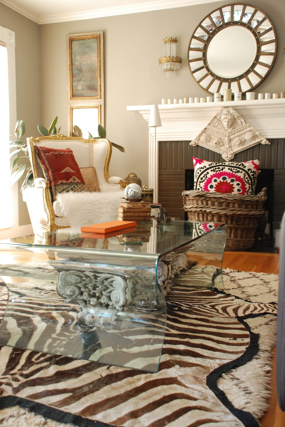 Architectural capitals are visible beneath the DWR glass coffee table.