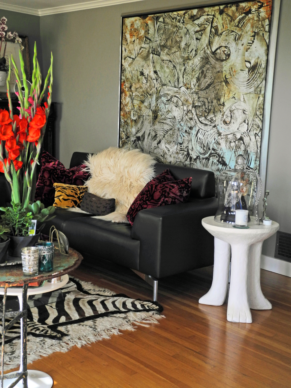 Muted abstract painting is the perfect backdrop for the living room.