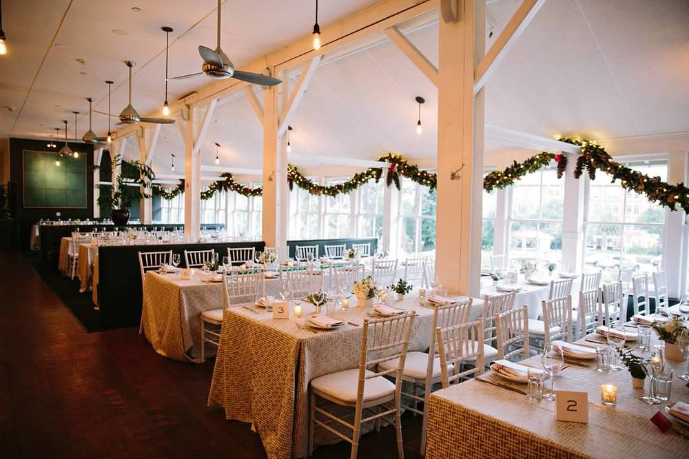 Simple floral arrangements and holiday garland allow the venue's historical beauty to shine.