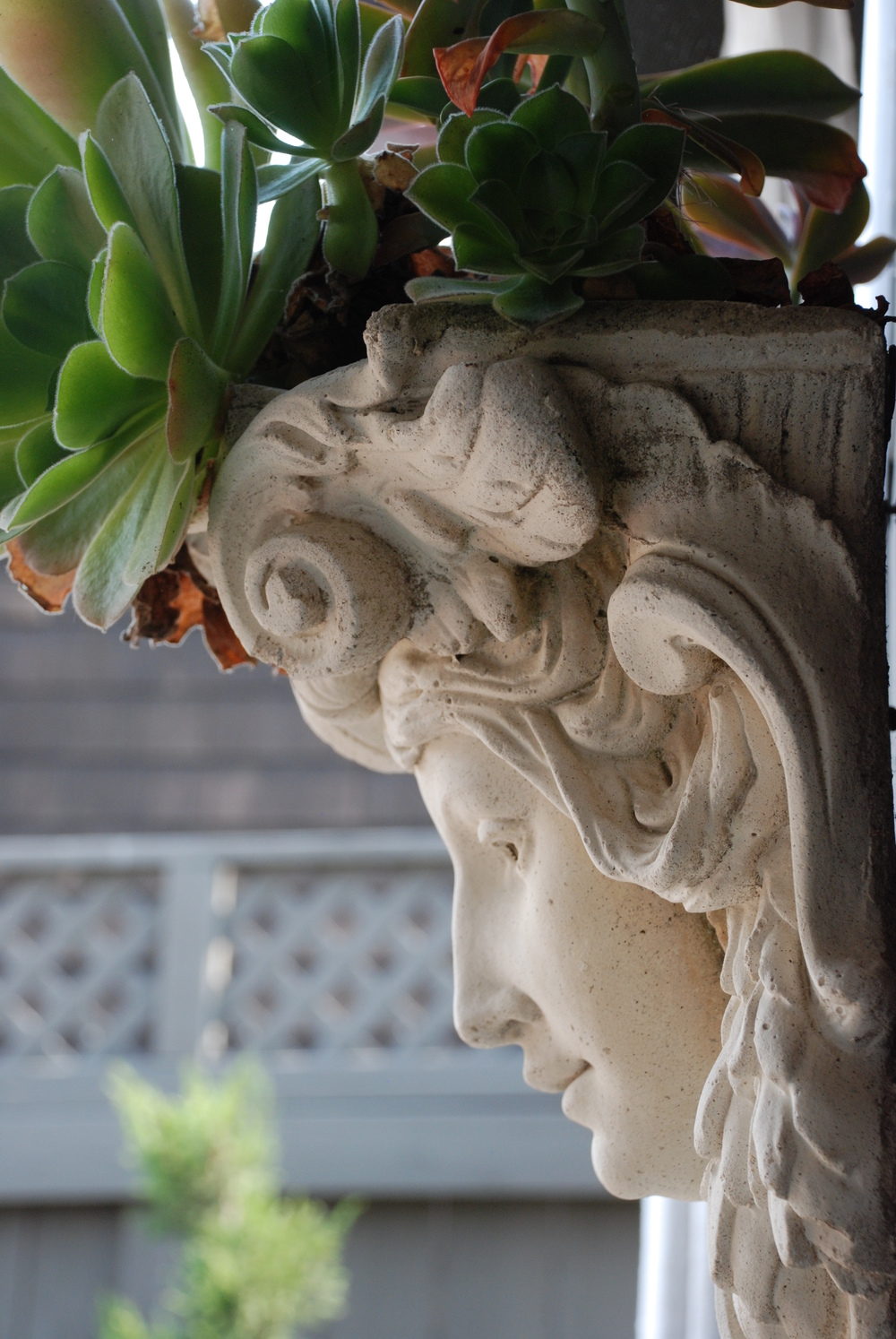 Antique Corbels Transformed Into Planters