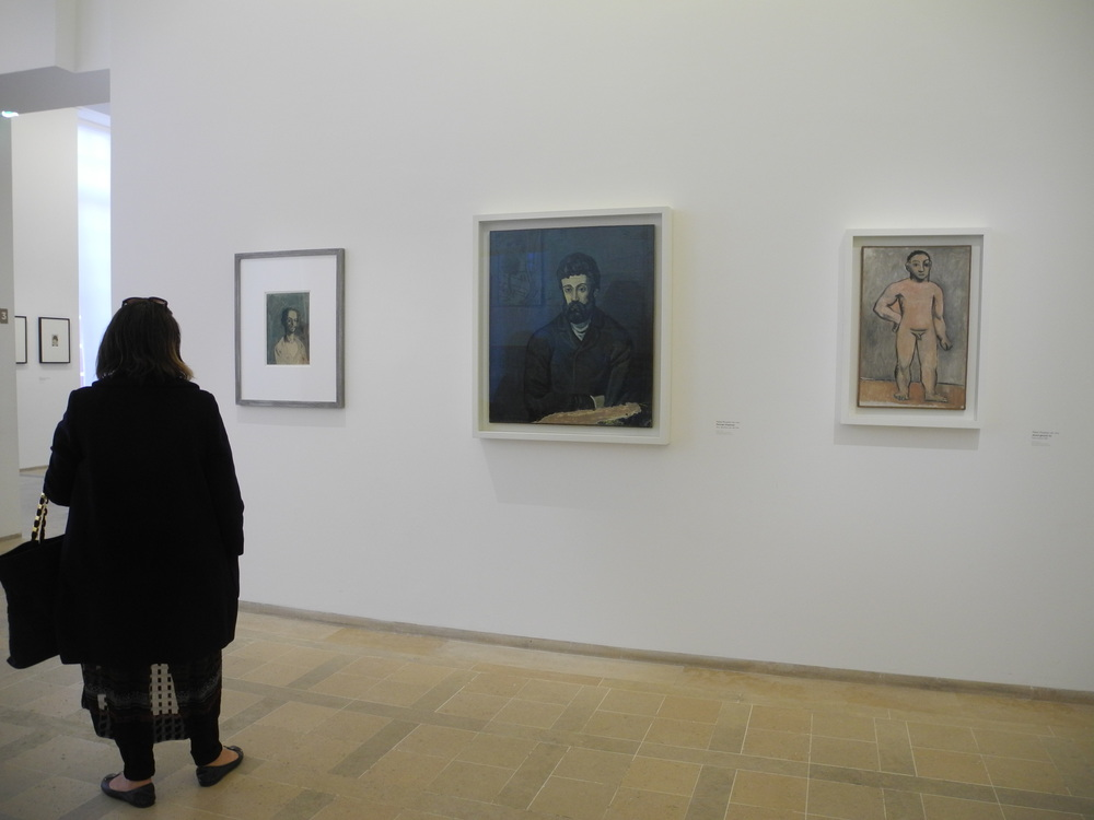 A museum lover viewing some of the 400 plus works on display.
