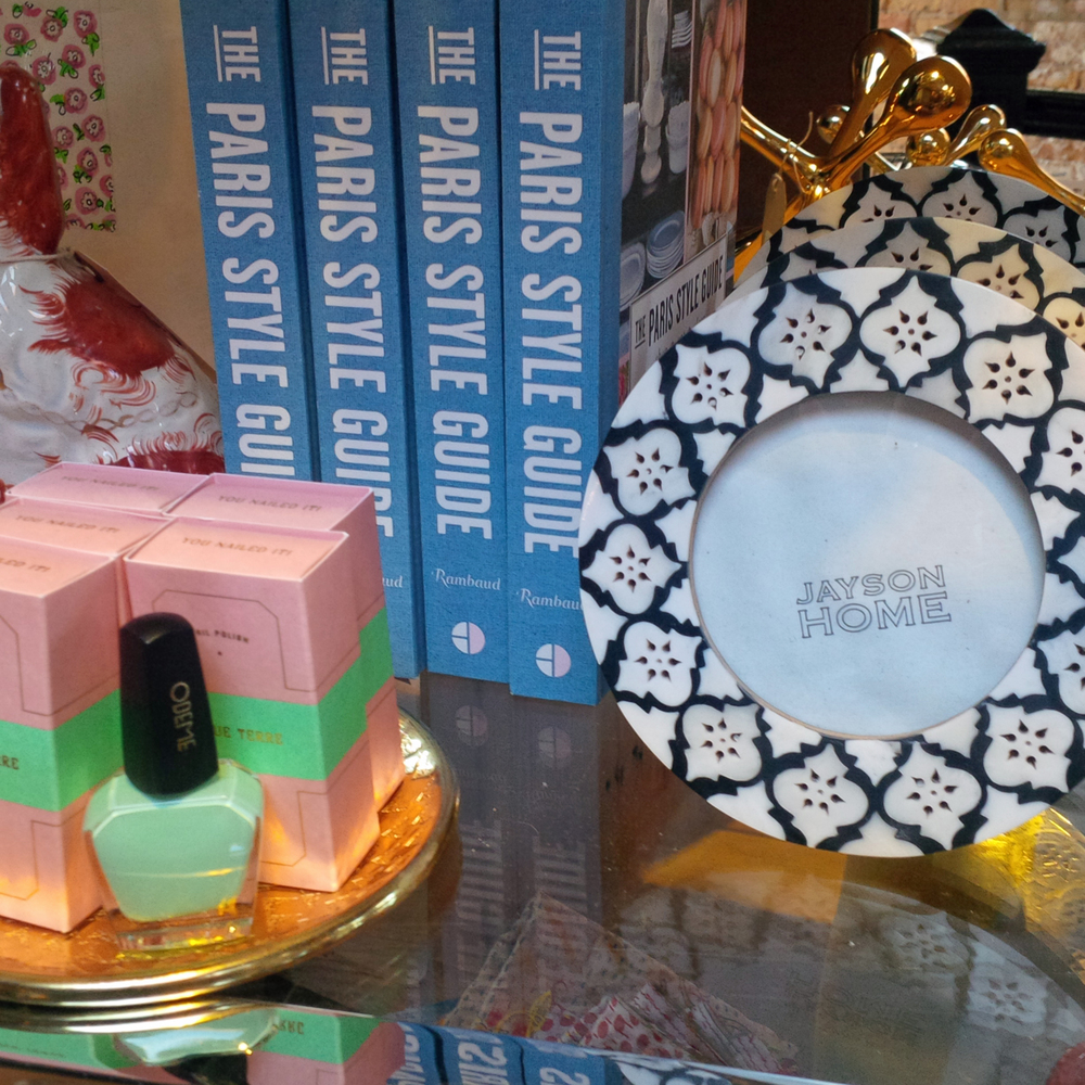 The candy colored Cinque Terre nail gloss from Odeme would be perfect for any gal's stocking. One could never have enough Paris guides, and the bone Inlaid back and white frame would add instant chic to any room.