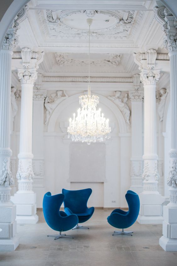 These blue mid-century chairs breathe life into this antique white space. {via  Happy Interior }