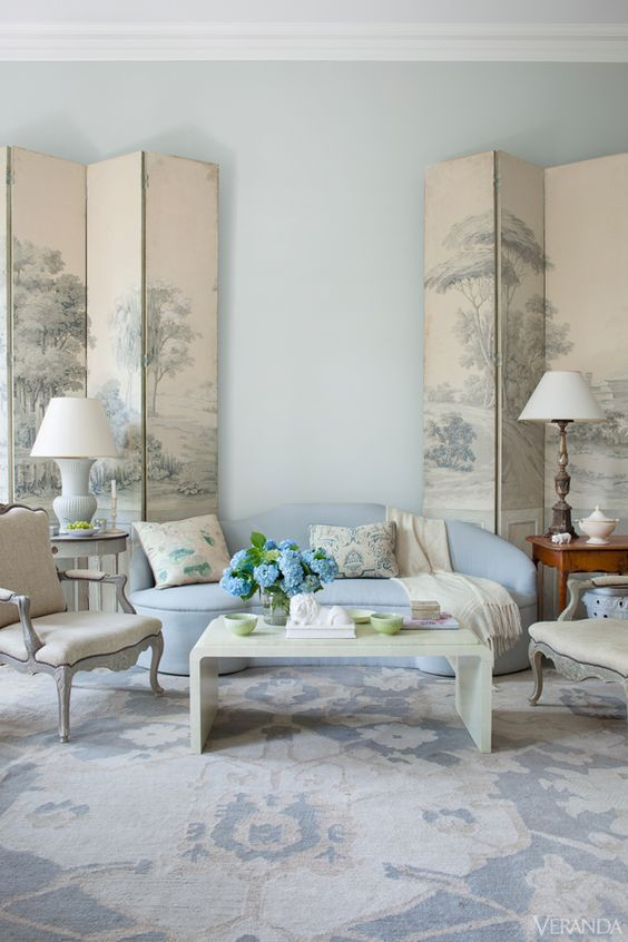 I love the muted Asian screens against the blue sofa. {via  Veranda }
