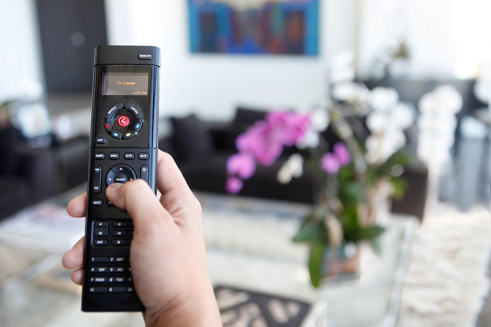 Our remotes take the headache out of using your entertainment system. Pictured: Control4 Wireless Rechargeable Remote