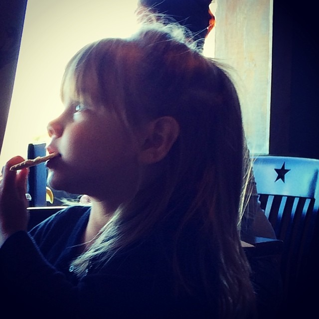Hannah B.  Watching the big boats (at Monument Inn)