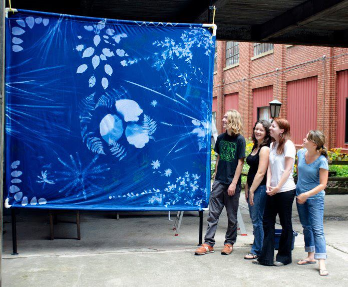 Miles and fellow Darkroom classmates with their cyanotype print. (2012). Photograph by Ralph Wilson.