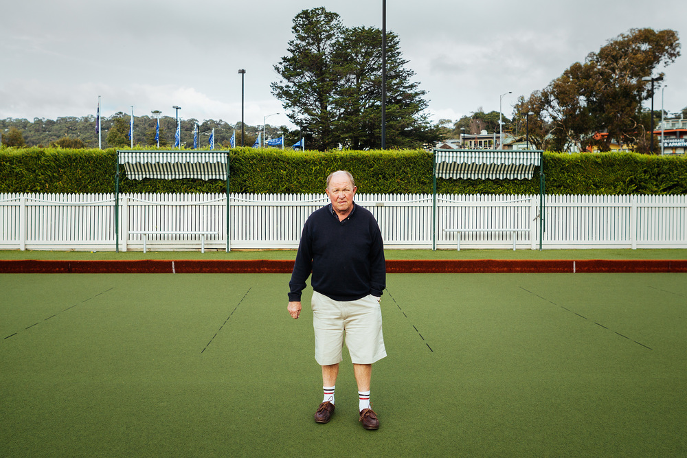 Sam Coulson stands on one of the greens at the Lorne Bowls Club where he has been President for a number of years. At a meeting 4 days later he stepped down to let a new President be elected.