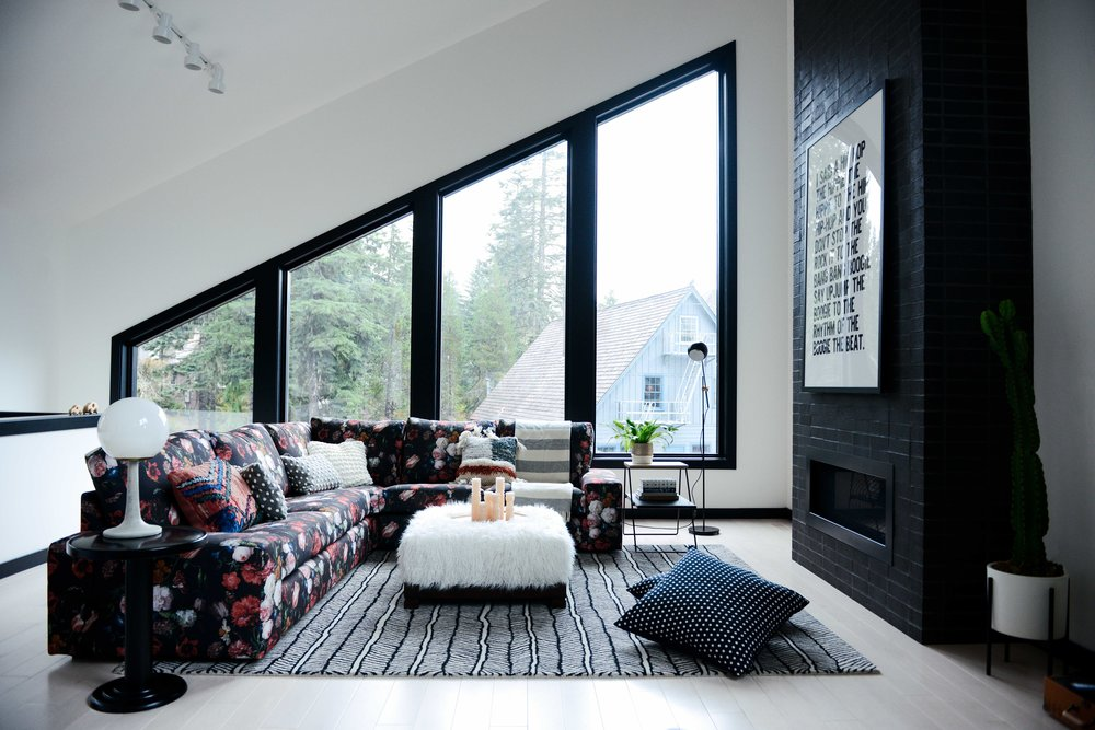 Modern Black & White Mountain Cabin Living Area with Custom Floral Sofa | Casework Interior Design | Portland, OR