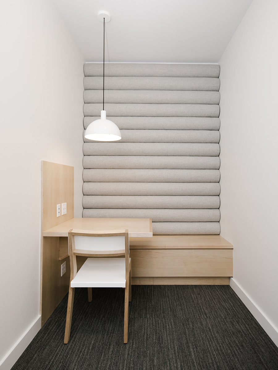 Bright Open Office Phone Room with Custom Upholstered Wall | Casework Interior Design | Portland, OR