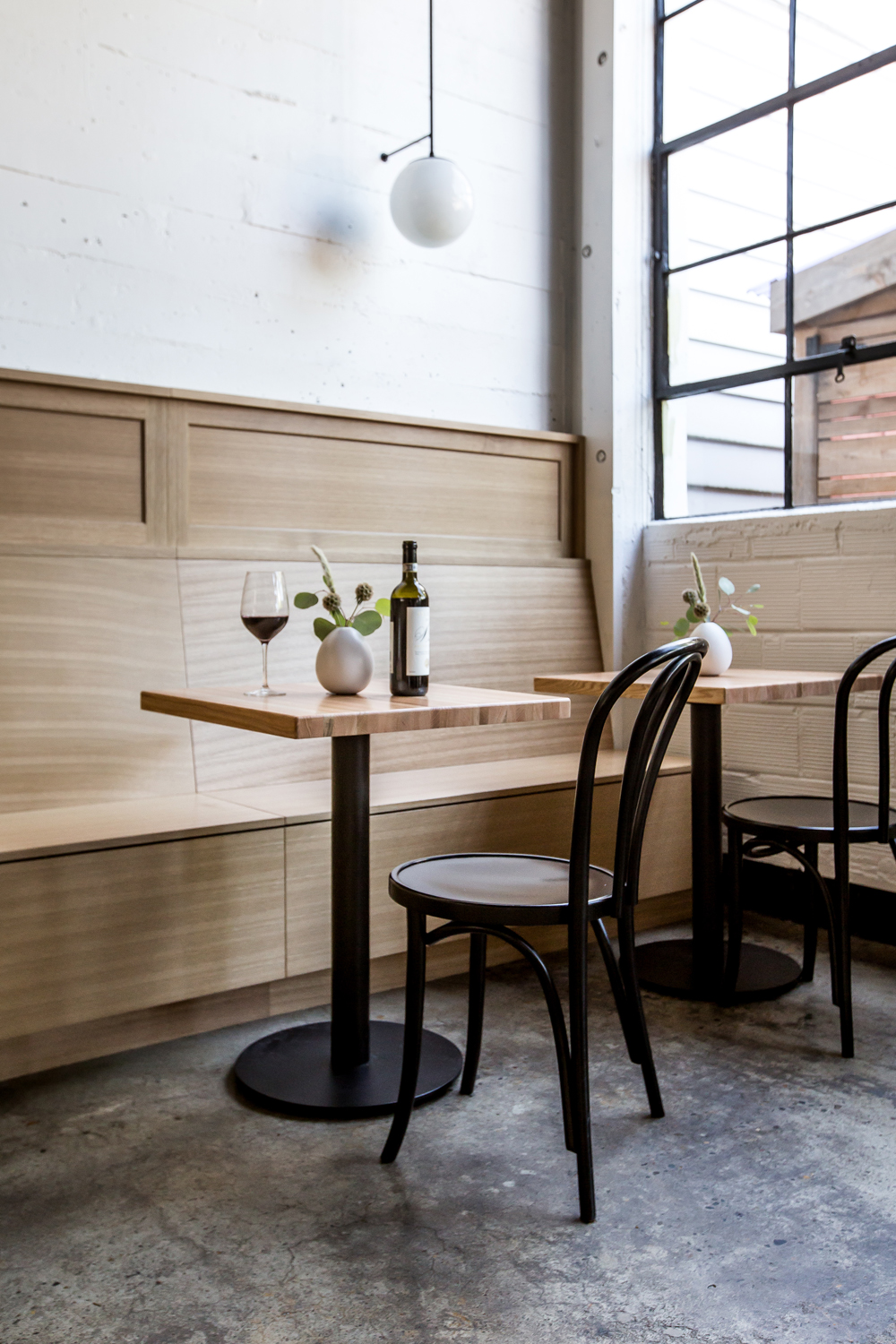 Oak banquettes are on each side of the restaurant.