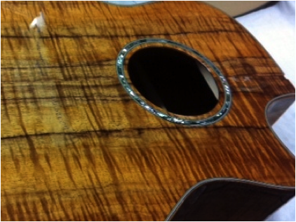 Guitar: white wood, sealer coat, between coat and finish sanded guitar boy (UV urethane finish)