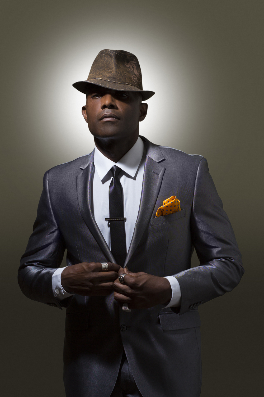 Sophis-Music-Suit-Fedora-Buttoning.jpg