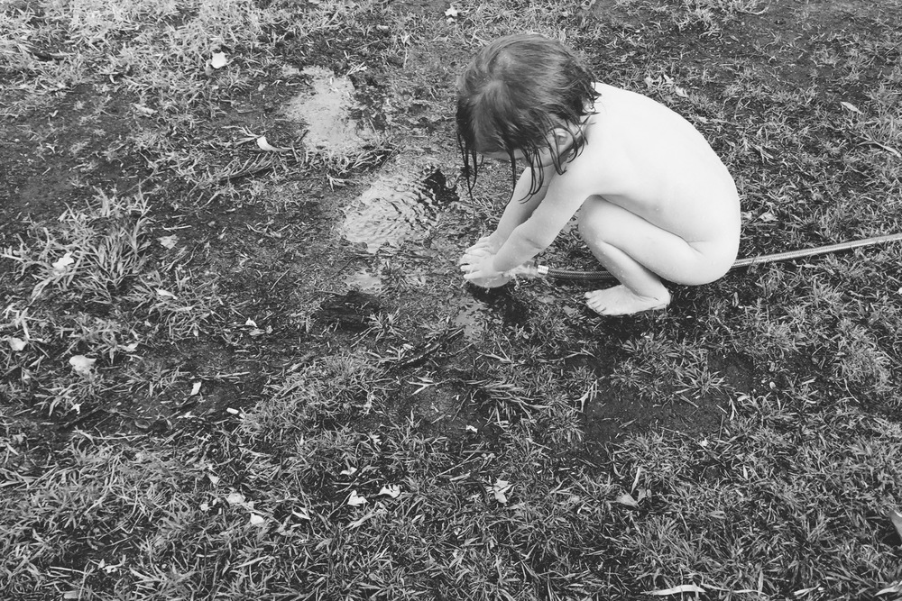 Here's my daughter playing with a hose on a hot, summer's day. Including the rest of the backyard in the photo would have been distracting - so I shot from above to keep the photo as simple as possible..
