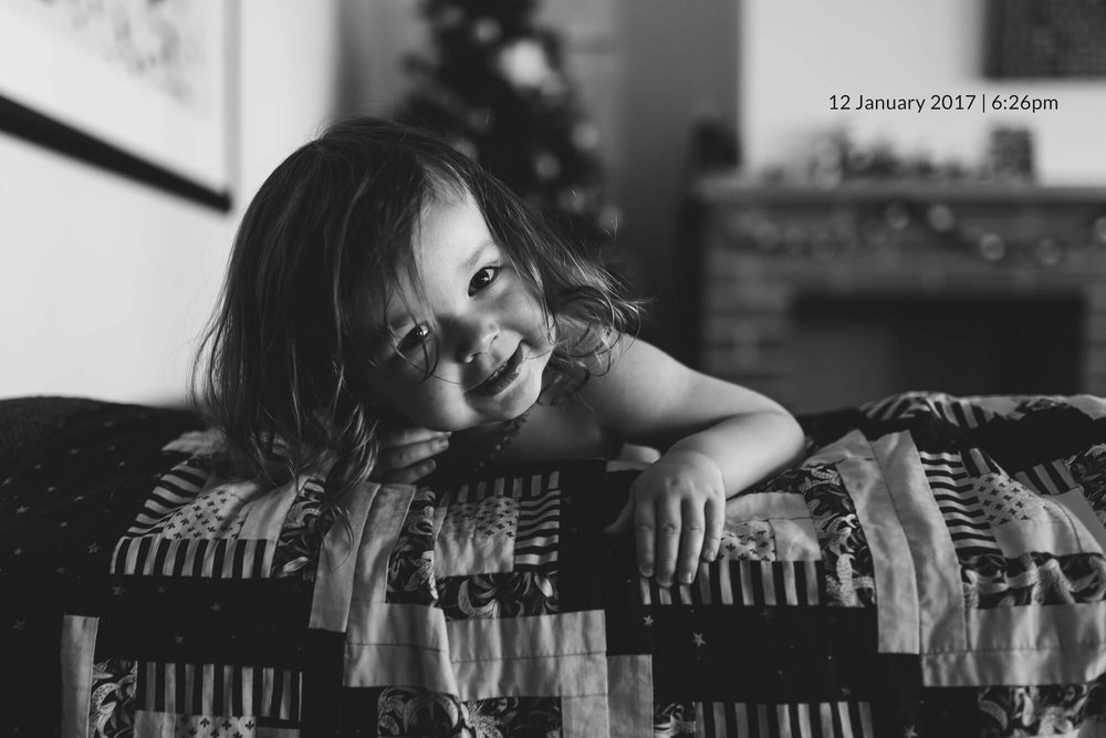 Family photographer in Melbourne. Black and white portrait of a toddler.