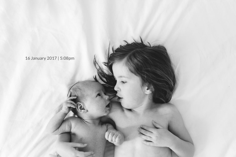 Melbourne family photography. Black and white portrait of a newborn baby and his big sister.