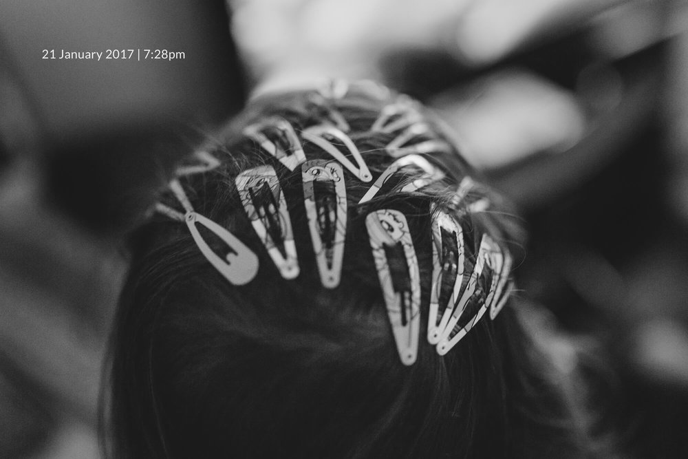 Melbourne lifestyle photography. Child wearing many hairclips.