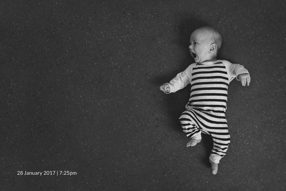 Melbourne newborn lifestyle photographer. Black and white portrait of a newborn baby.