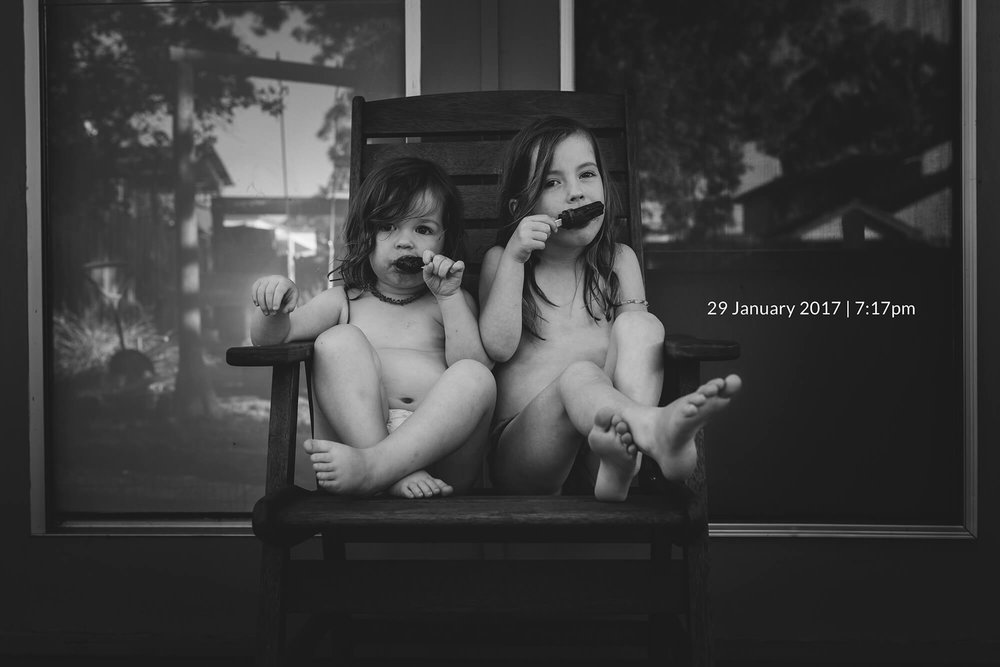 Lifestyle photographer in Melbourne. Portrait of sisters eating ice creams.