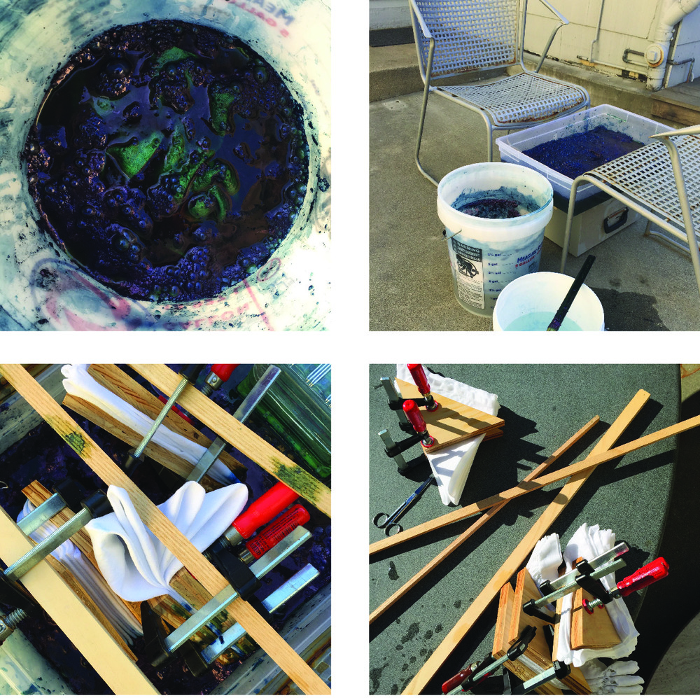 Our home improvement projects have yielded a plethora of clamps and wood scraps, shown here with the dye baths.  The clamps work well for suspending the bordered items in the dye bath, as well as creating the resist areas.
