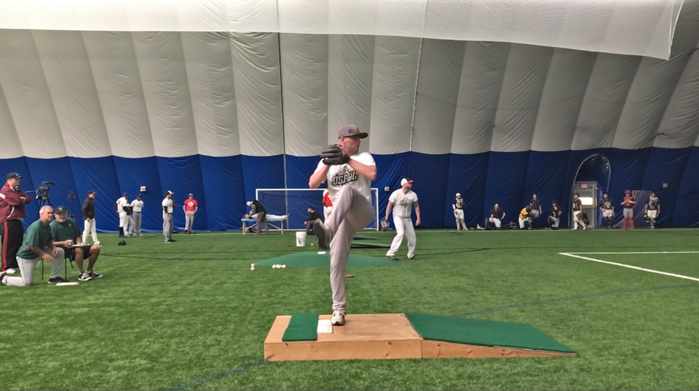 Tryout hopeful throwing in front of coaches