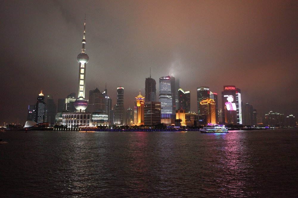 Shanghai skyline near the Pudong River.    Shanghai, China. 03 June 2010. 1/60 s, f/4, -2/3 EV, ISO 3200, 27 mm, EOS 5D Mark II + EF 24-70 f/2.8 L