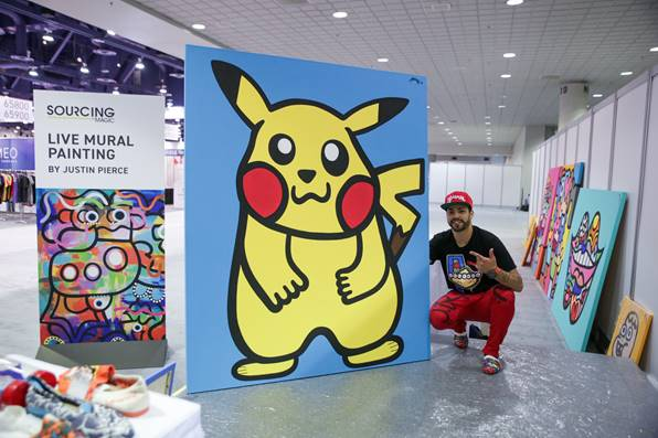 URBAN ARTIST, JUSTIN PIERCE, LIVEPAINTED A MURAL ON THE SOURCING SHOW FLOOR